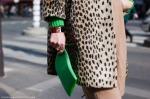 leo-coat-with-green-clutch-and-fendi-bracelet-via-stockholm-street-style