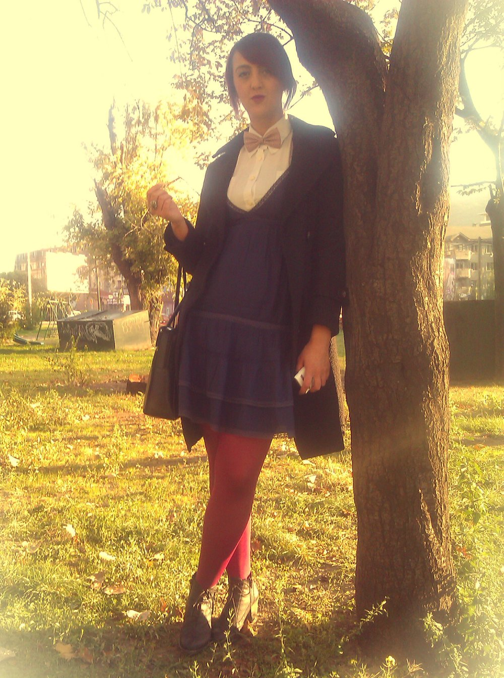 White shirt: vintage; Navy dress: Stradivarius; Bow-tie & Oxford shoes: Old Bazaar Skopje; Burgundi tights: Penti; Black coat: Lukas Shopping Center Prilep; Black leather laptop bag: vintage Samsonite